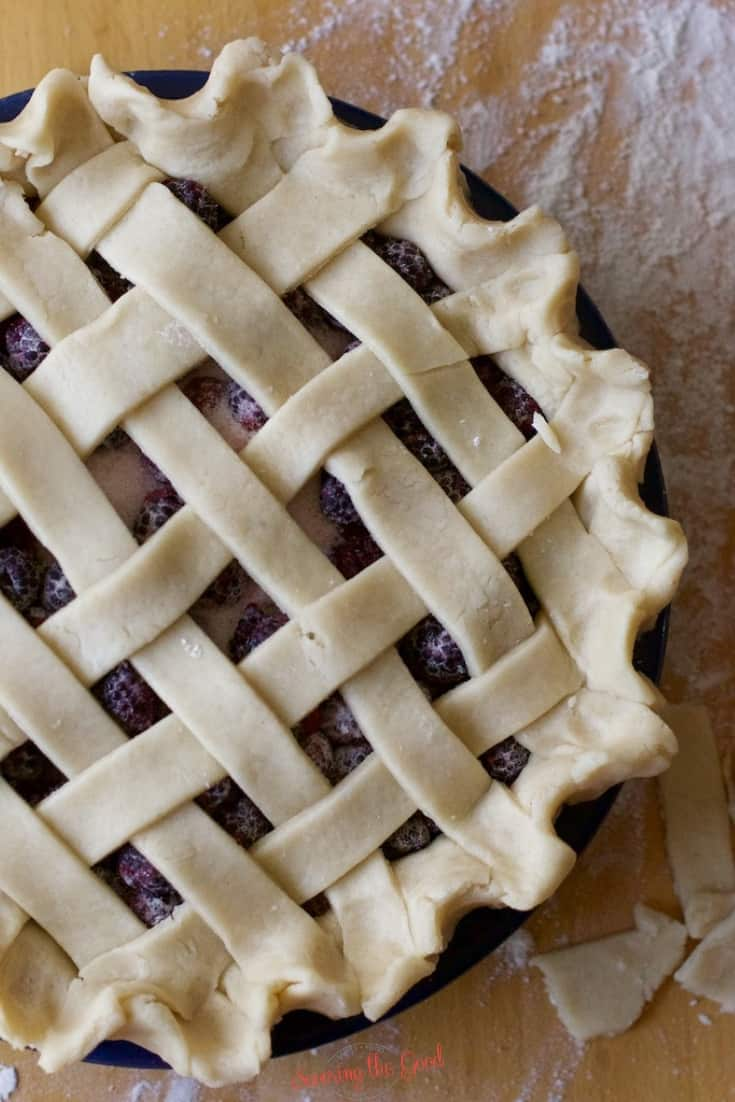 black raspberry pie with lattice top un baked on flour dusted surface