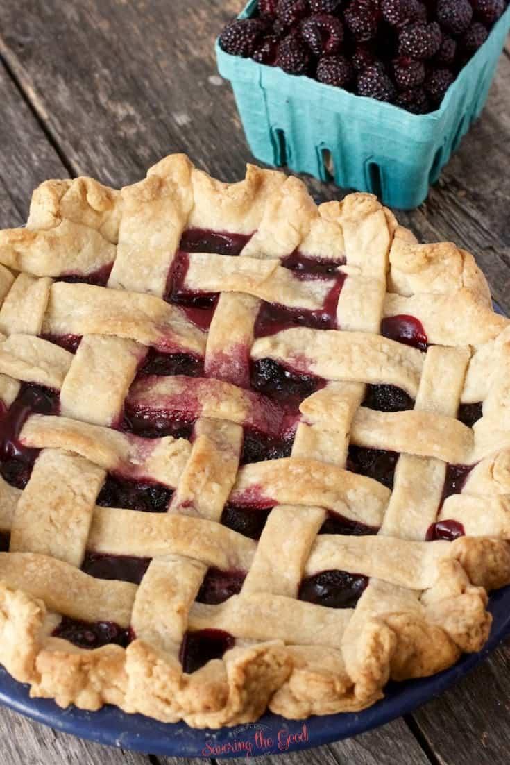 full black raspberry pie with lattice top baked golden