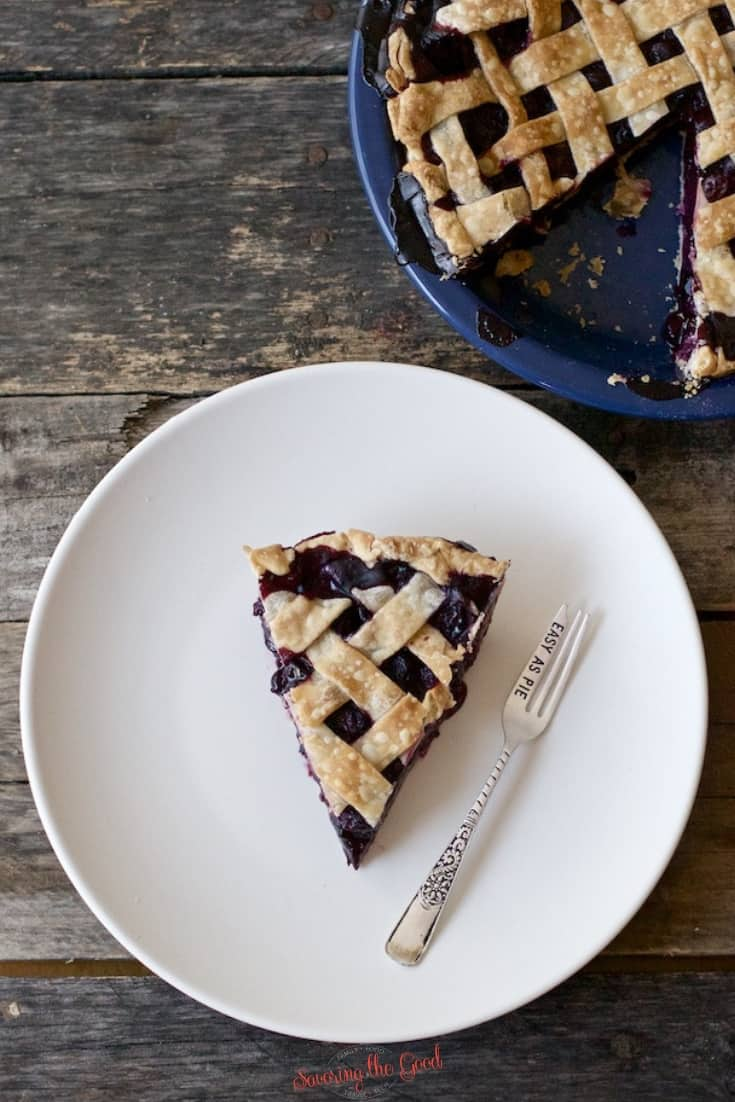blueberry pie fresh on a white plate