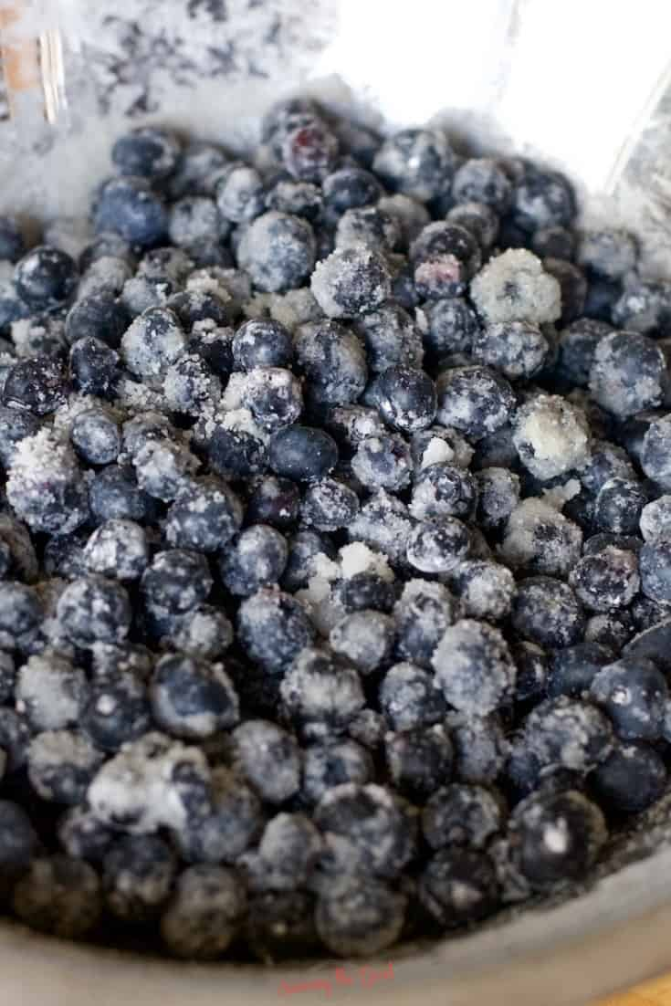 fresh blueberries with sugar and cornstarch tossed in a bowl for pie
