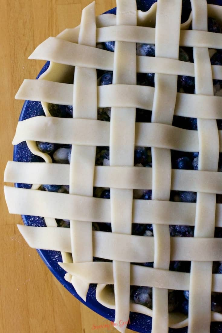 raw lattice topped blueberry pie