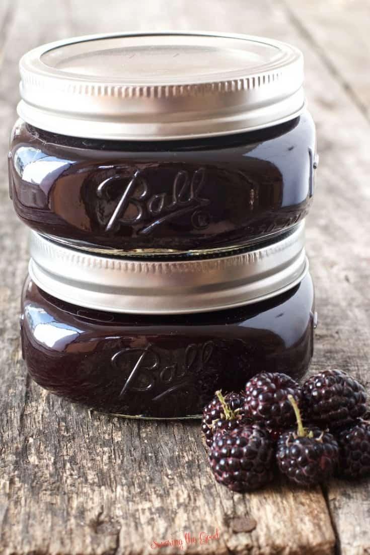 2 jars of seedless black raspberry jam with fresh berries