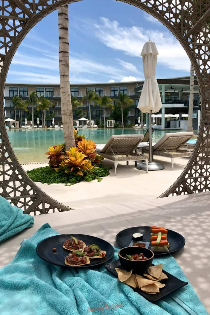 pool side service snacks in a Bali bed looking at the pool of Haven Riviera Cancun