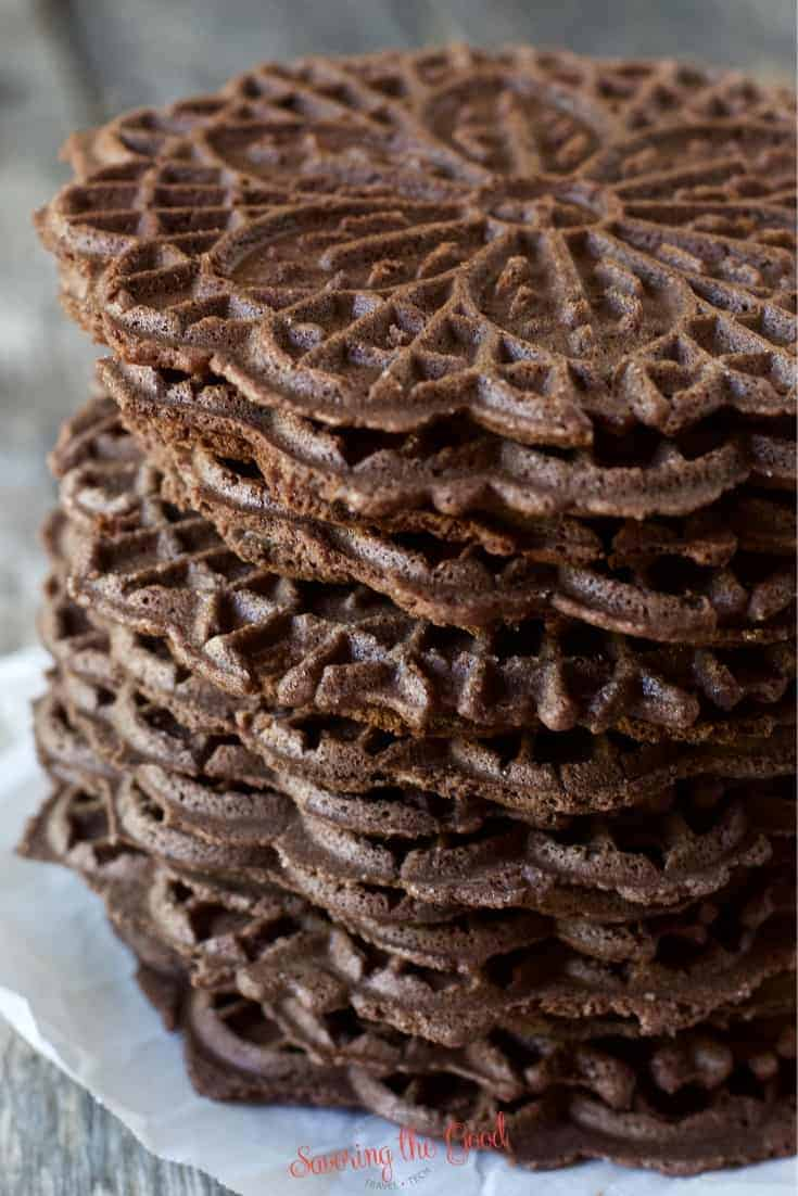 tight shot of chocolate pizzelles stacked on top of each other
