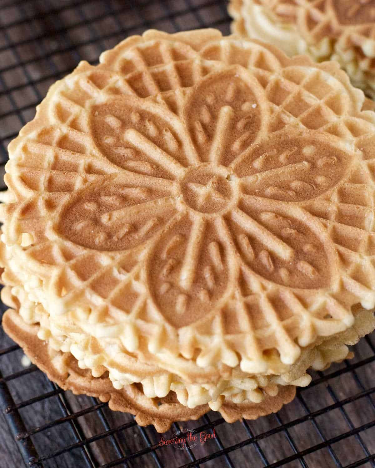 close up of a small stack of lemon pizzelle cookies