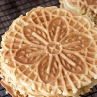 tight shot of a golden brown lemon pizzelle cookie
