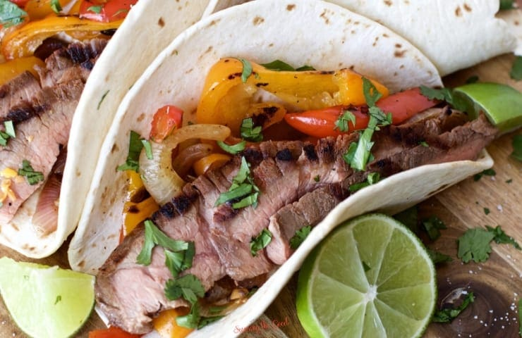 sous vide flank steak fajita in a flour tortilla