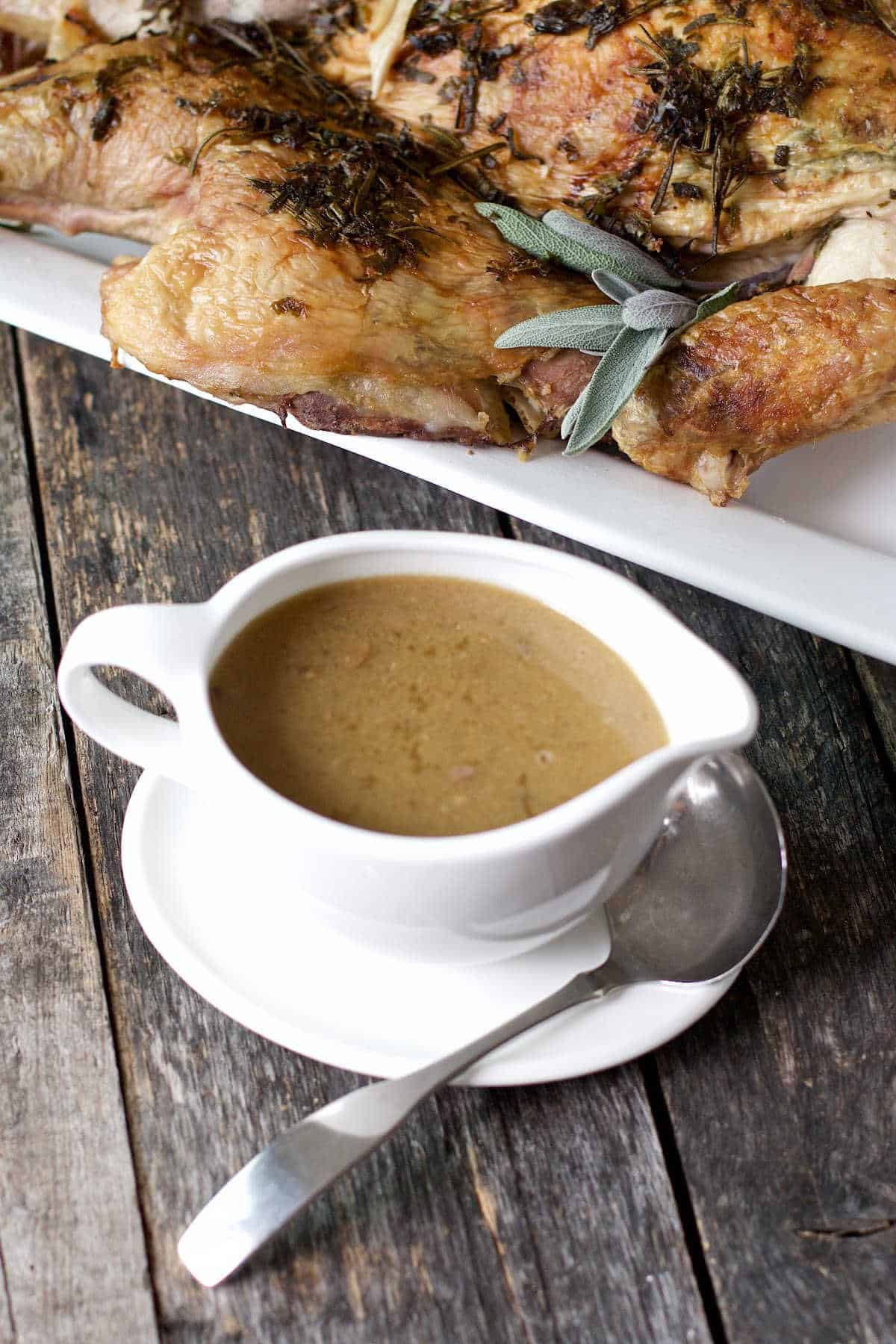 giblet gravy recipe in a white serving dish with ladle