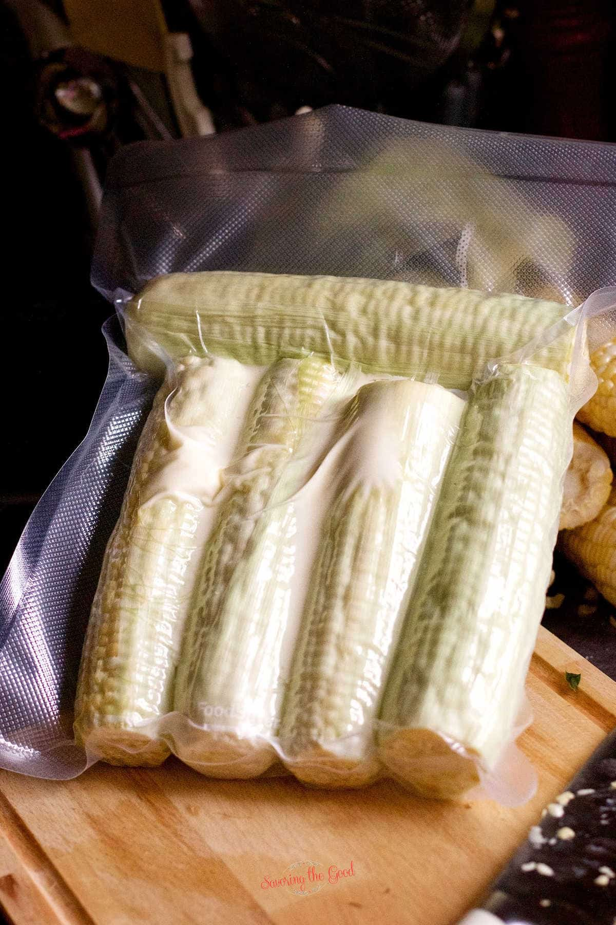 sous vide corn on the cob with butter sealed in a bag.