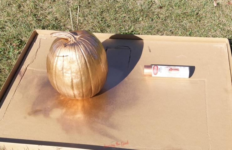 painting a Mickey Mouse Pumpkin gold