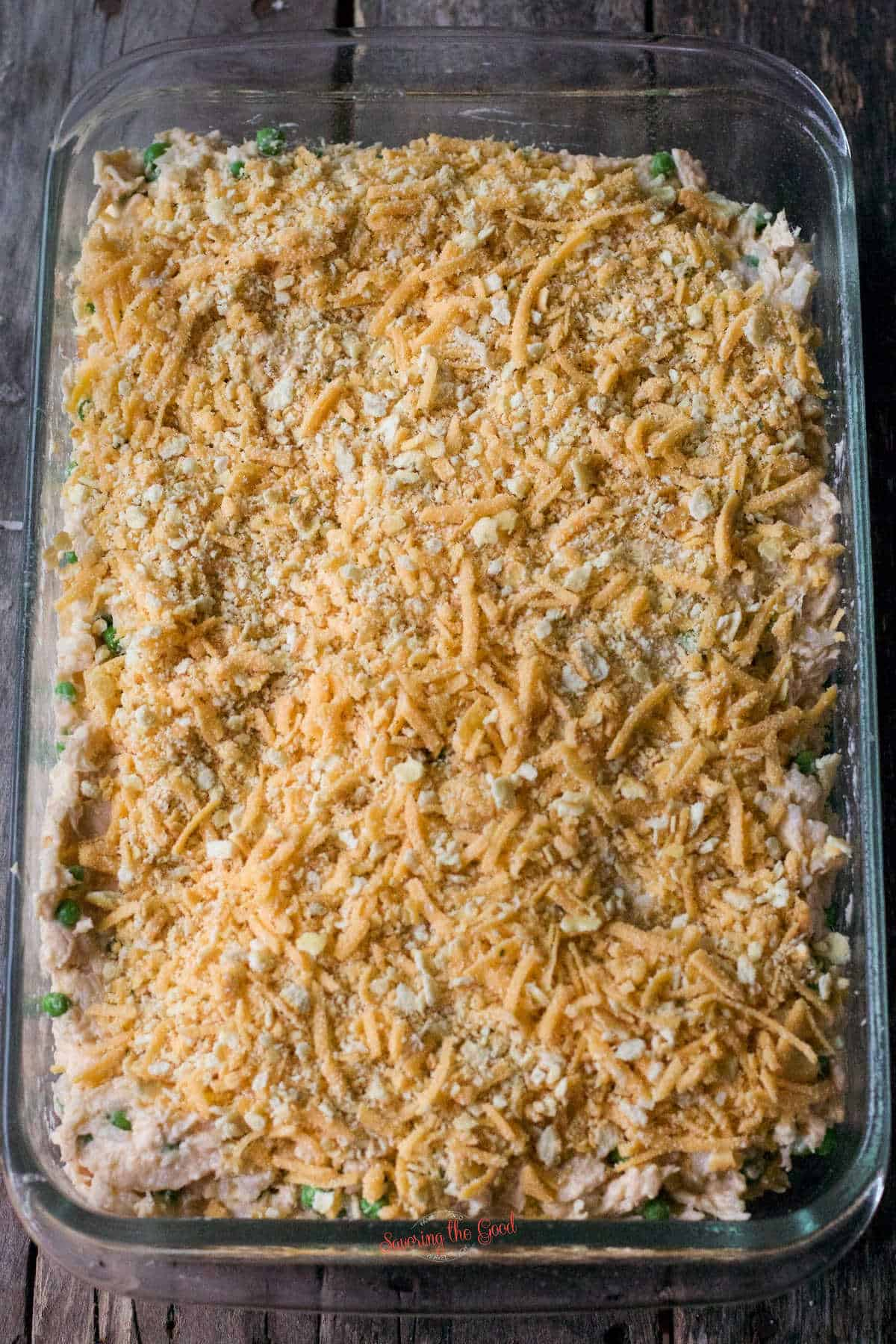 unbaked cheesy chicken casserole in a glass dish