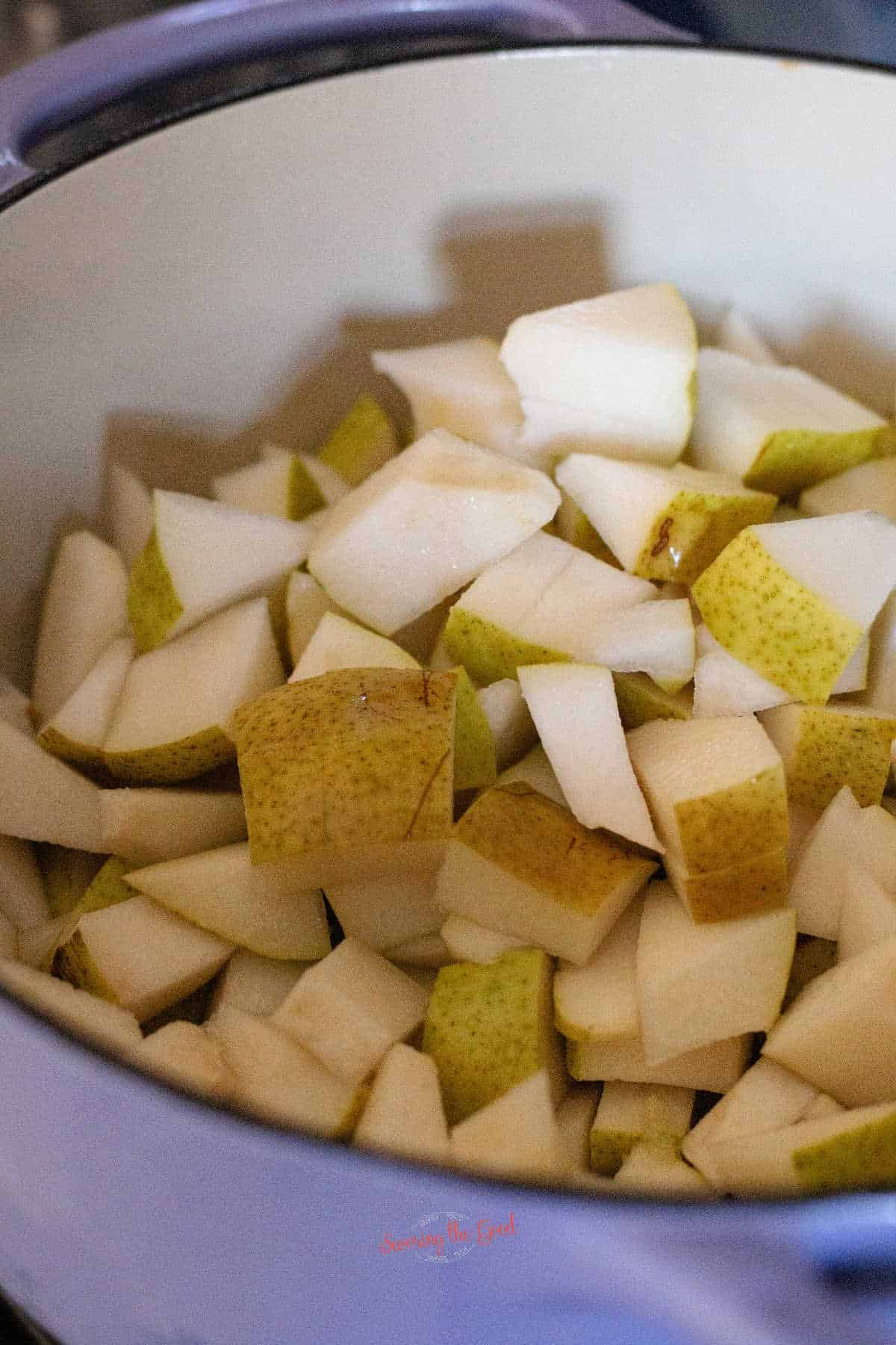 cup up pears in a pan for sauce