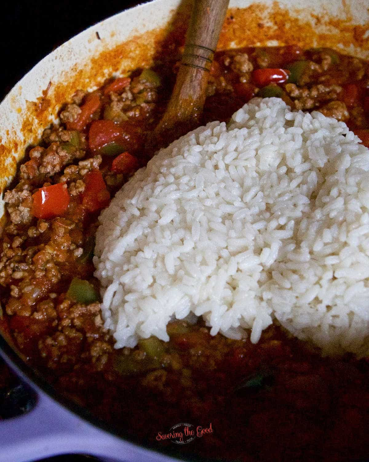 adding cooked rice to stuffed pepper soup