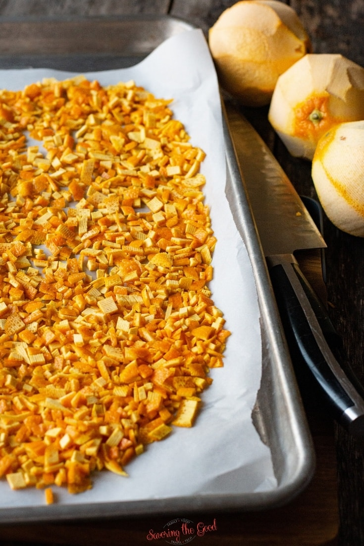 diced orange peel on a baking sheet with parchment paper