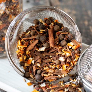 copycat William Sonoma mulling spices spilling out of a tea ball
