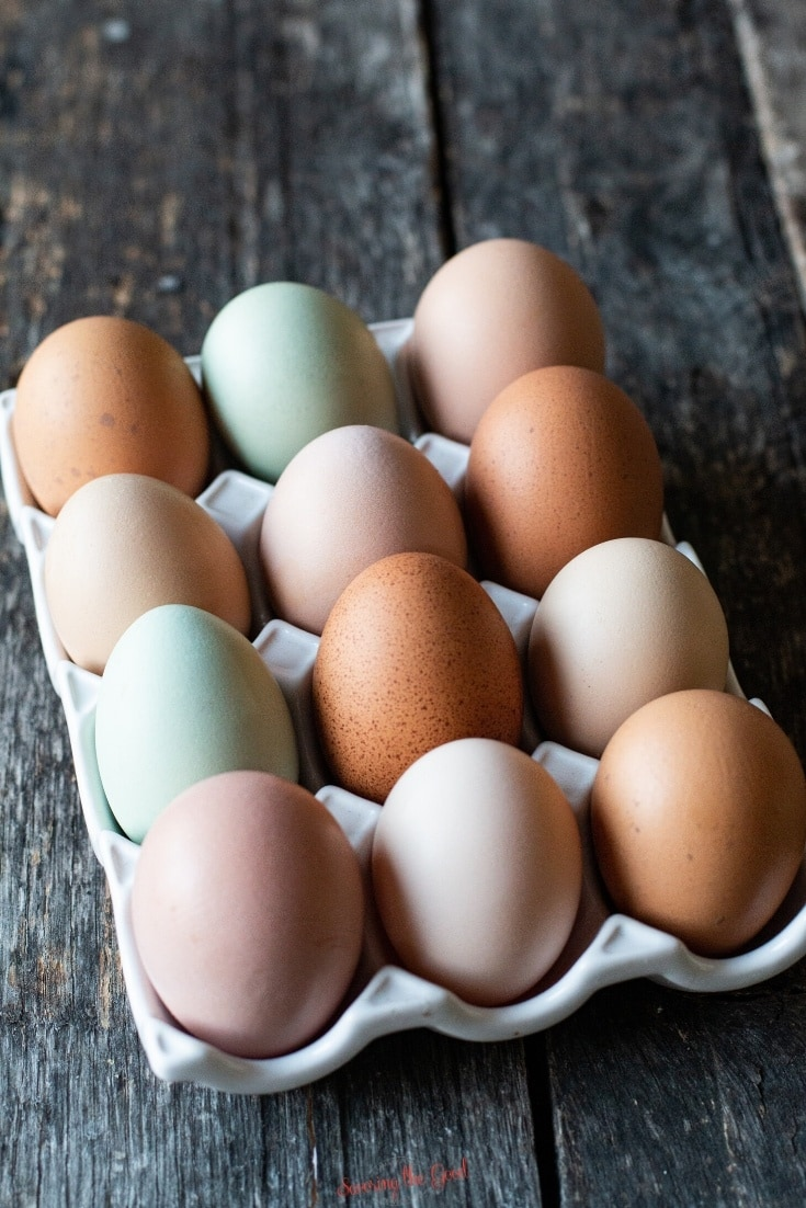 farm fresh eggs in a white porcelain egg carton