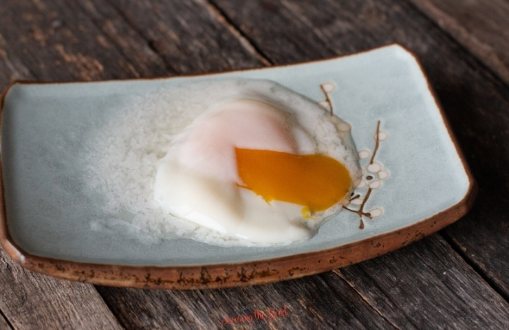 60 degree egg on a plate with a broken yolk