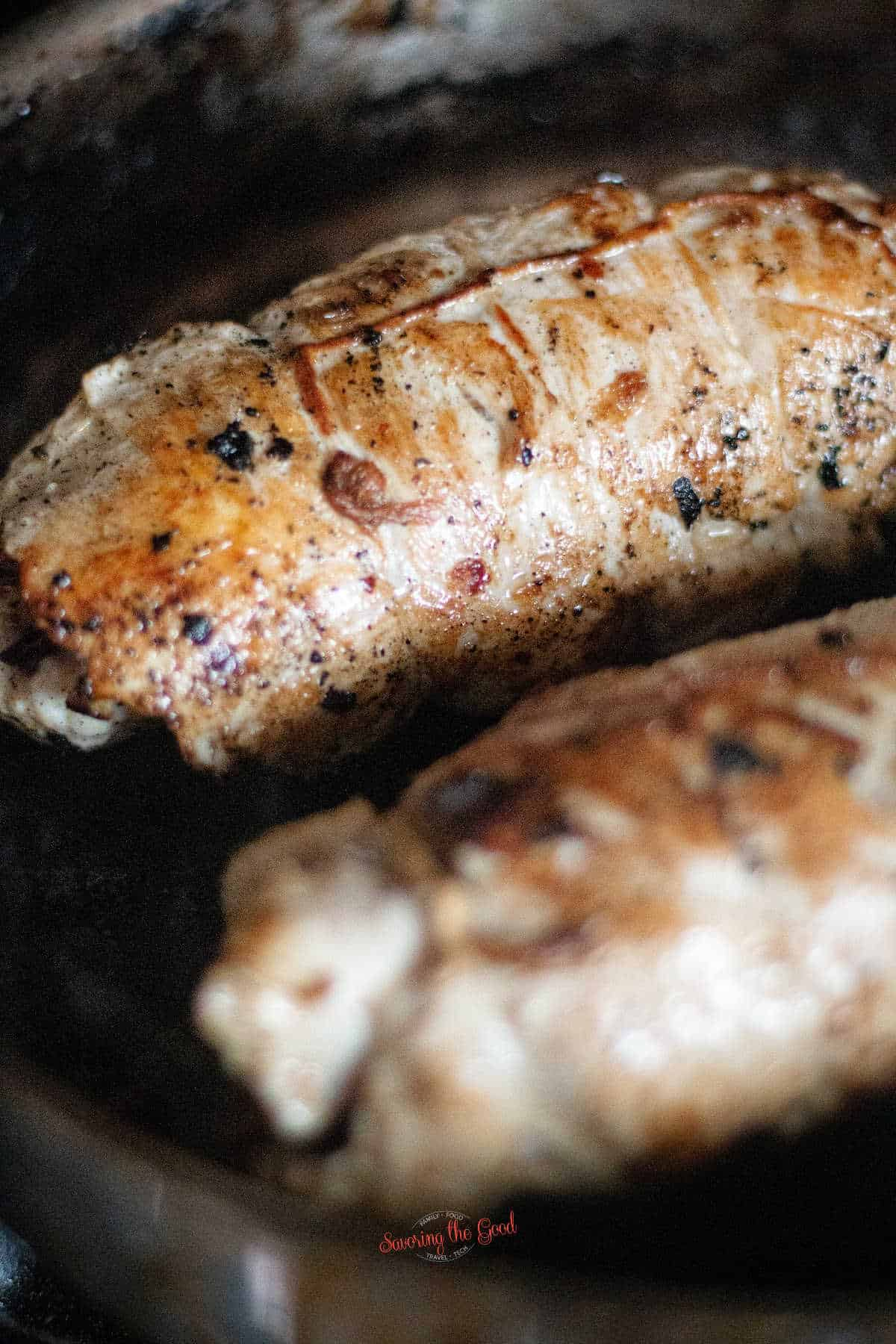 2 seared turkey roulades in a cast iron pan