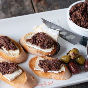Olive tapenade on bread with cheese
