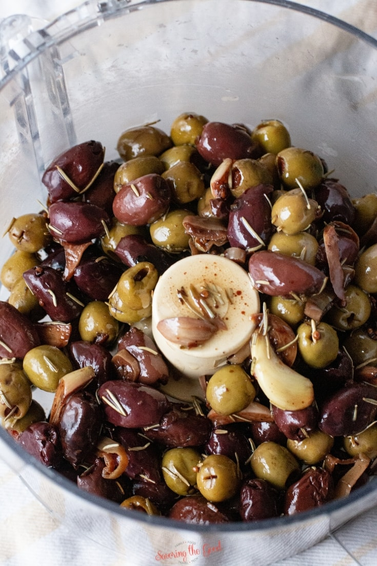 olives in a food processor ready to be blended