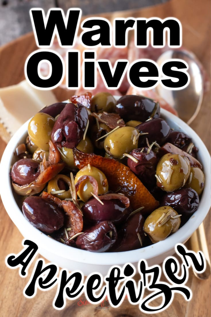 warm olives in a white bowl with text for Pinterest