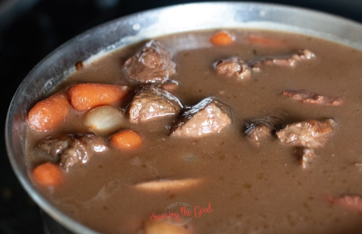 Guinness Beef Stew in a pan with the gravy thickening