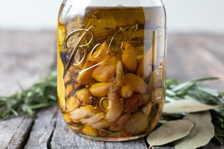 tight shot of garlic confit in a ball canning jar, horizontal image