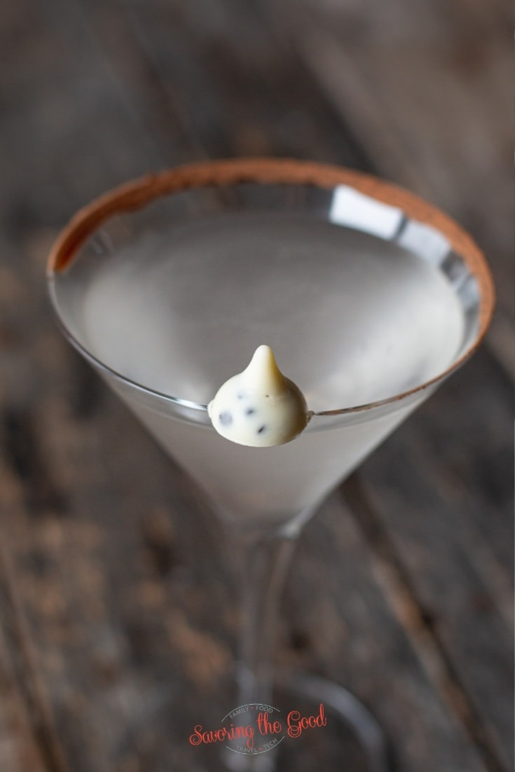 white hershey's kiss balanced on the edge of a martini glass