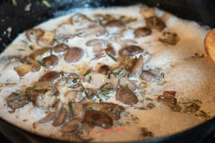 mushroom, rosemary cream reducing in a cast iron pan.