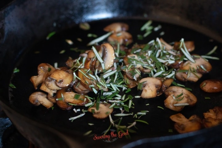 sautéed mushrooms and rosemary in a cast iron pan