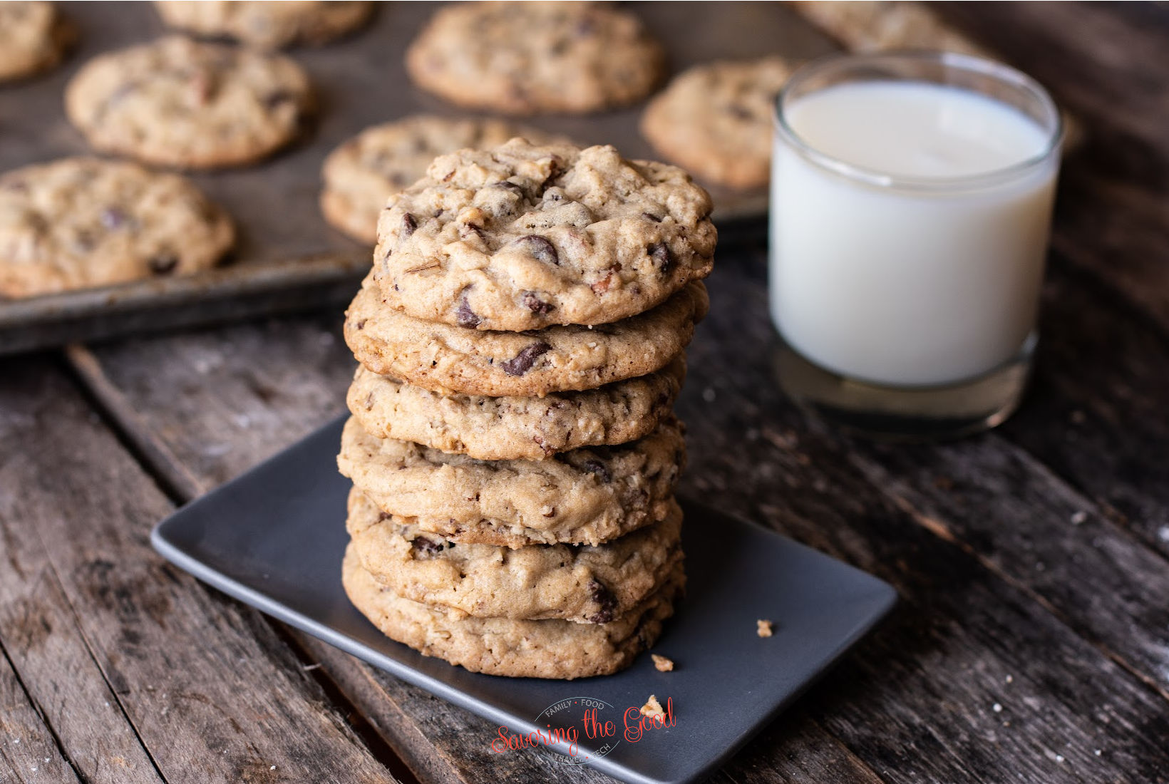 The Original DoubleTree Cookie sticked on a plate with milk in the background