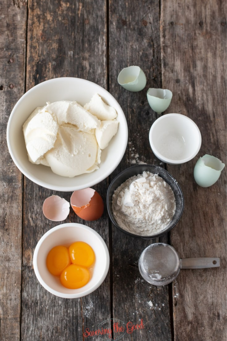 gnudi ingredients in bowls on a wooden surface