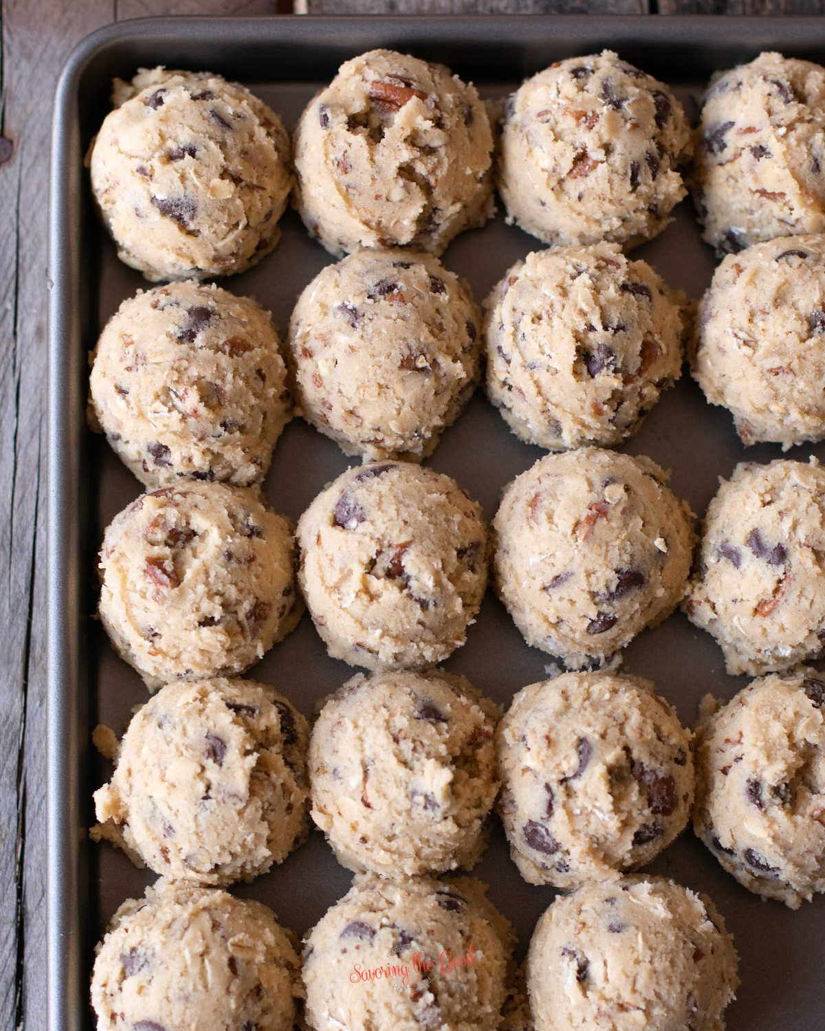 doubletree cookies scoops on a cookie sheet for freezing