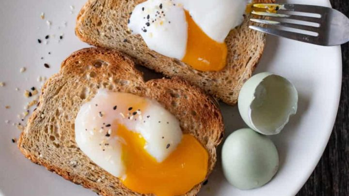 Sous vide eggs on toast, broken to show the runny yolk