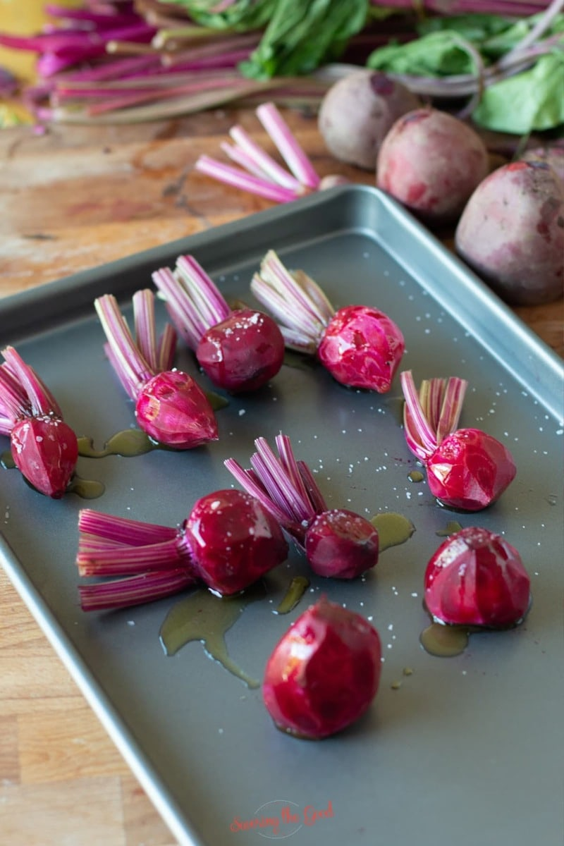 baby red beets on a tray to be roasted in the oven
