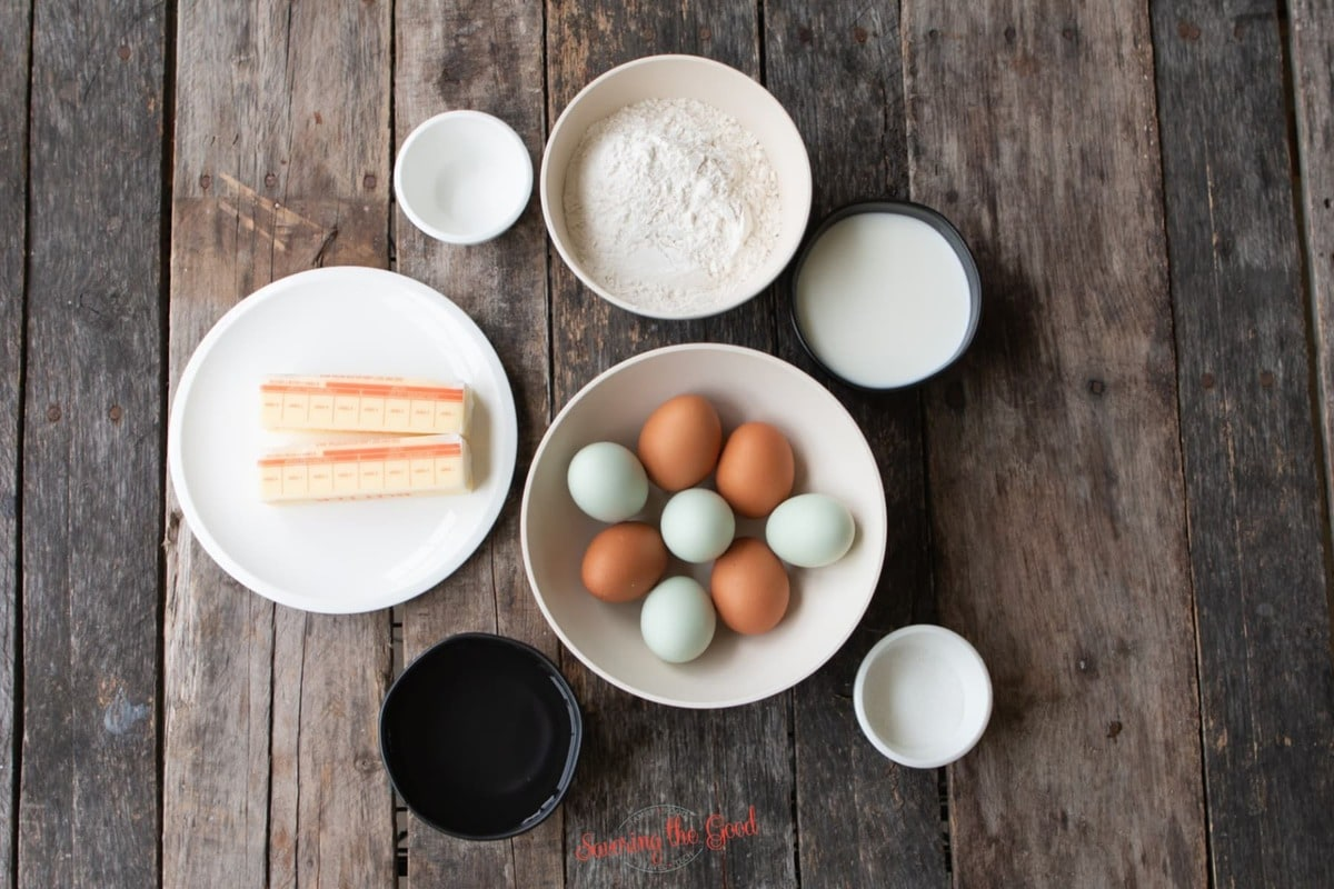 pate choux ingredients in bowls on a wooden surface