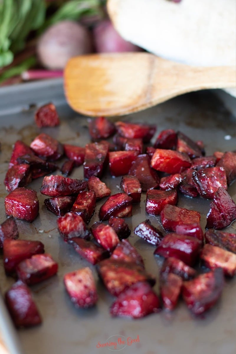 roasted diced beets with bamboo spoon