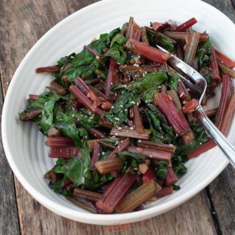 Beet Greens in a serving bowl, square image
