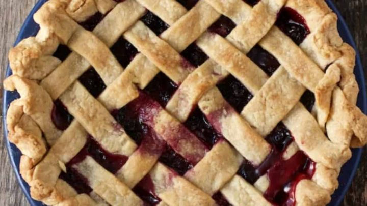 Black Raspberry Pie baked in a blue pie plate