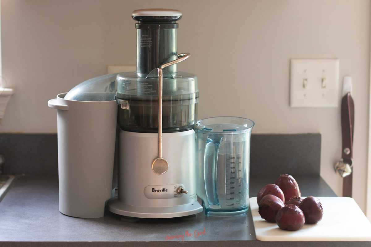 breville juicer with fresh beets on the counter for juicing.
