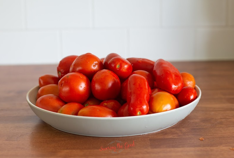 plate of fresh tomatoes for canning