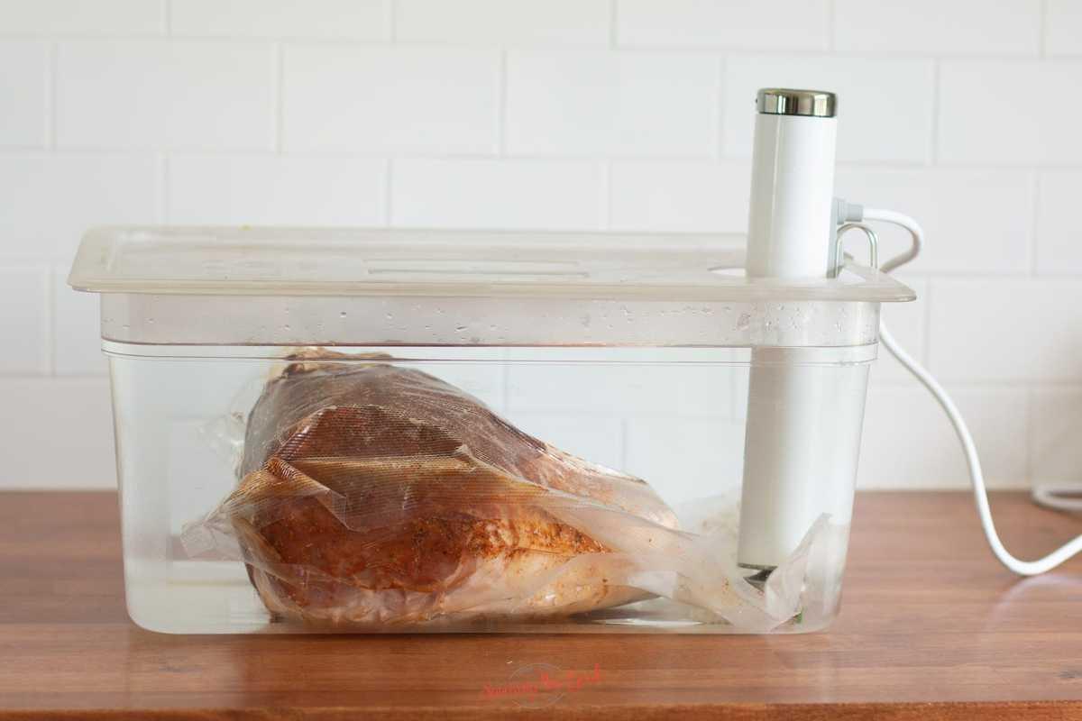 pork shoulder in a vacuum bag in water