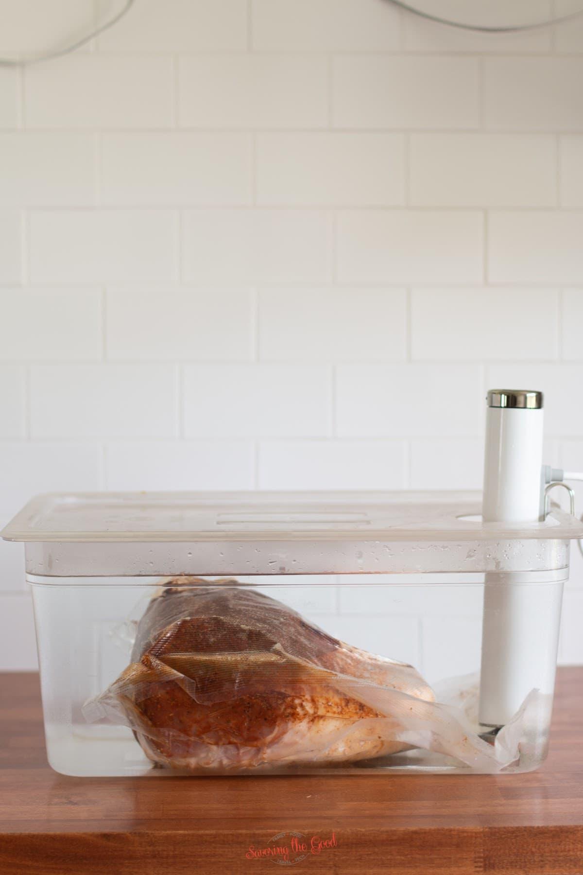 sous vide pork shoulder in a sous vide bath