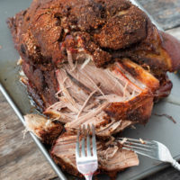sous vide pork shoulder recipe on a sheet pan