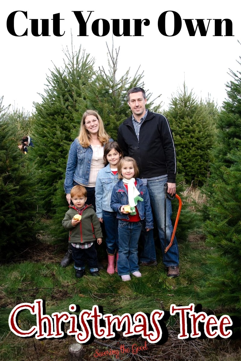 family of 5 posing with their tree at a cut your own christmas tree farm