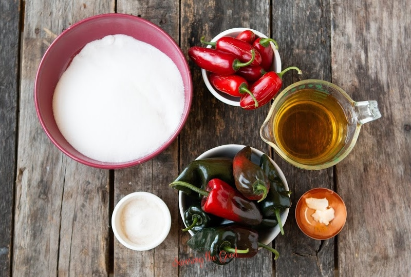 pepper jelly ingredients in bowls on a wooden board