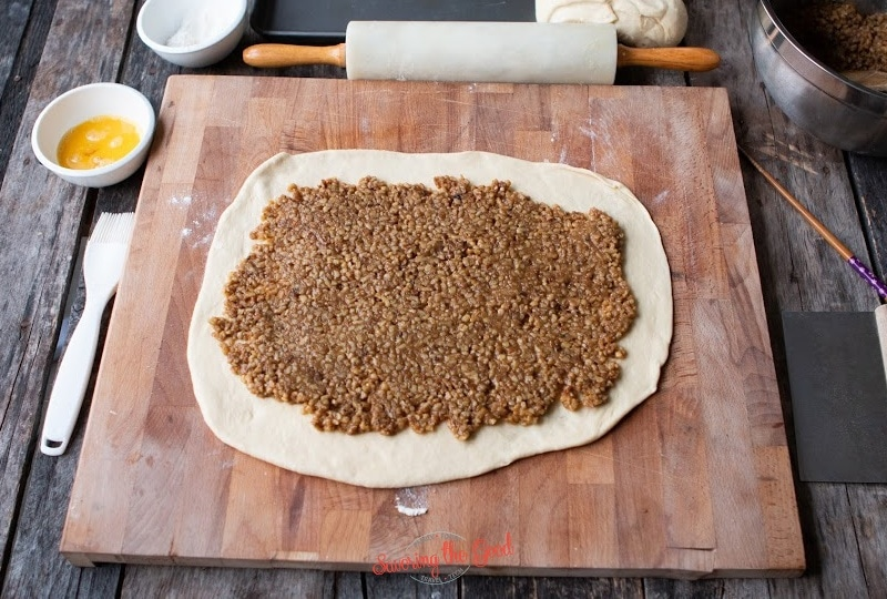 nut mixture on a rolled out dough for nut rolls