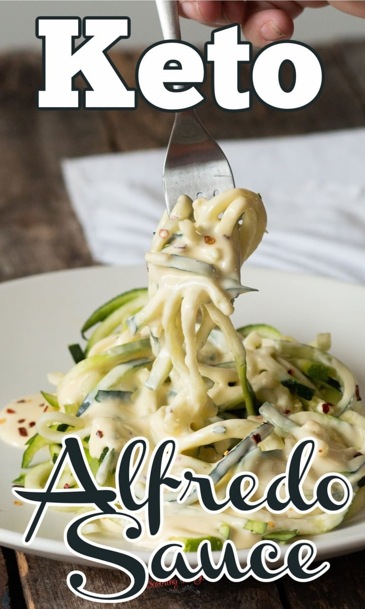 Keto Alfredo Sauce on zucchini noodles being pulled up on a fork.