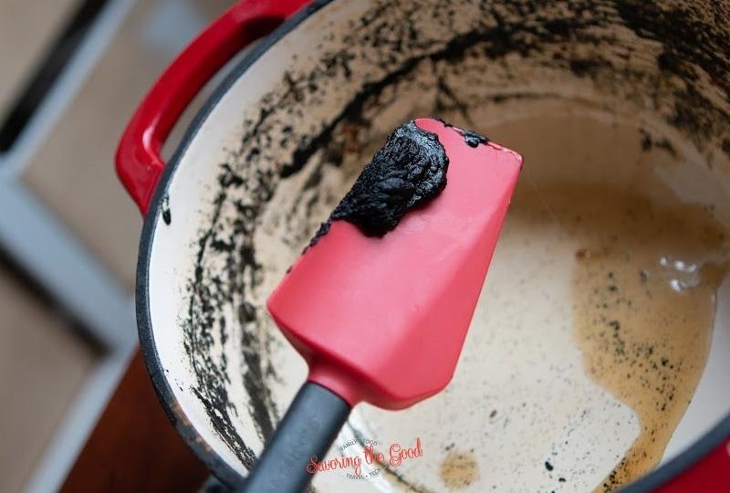 scraped vanilla bean paste on a red spatula