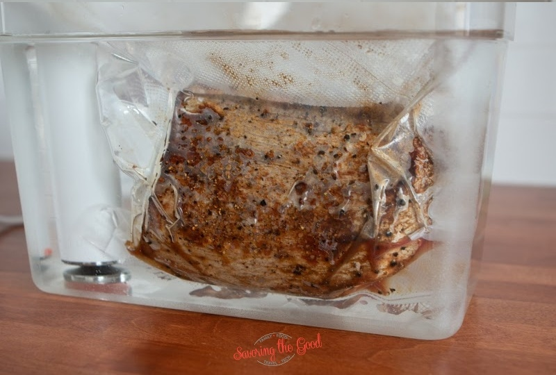 second image of sous vide chuck roast in a sous vide bag in a water bath